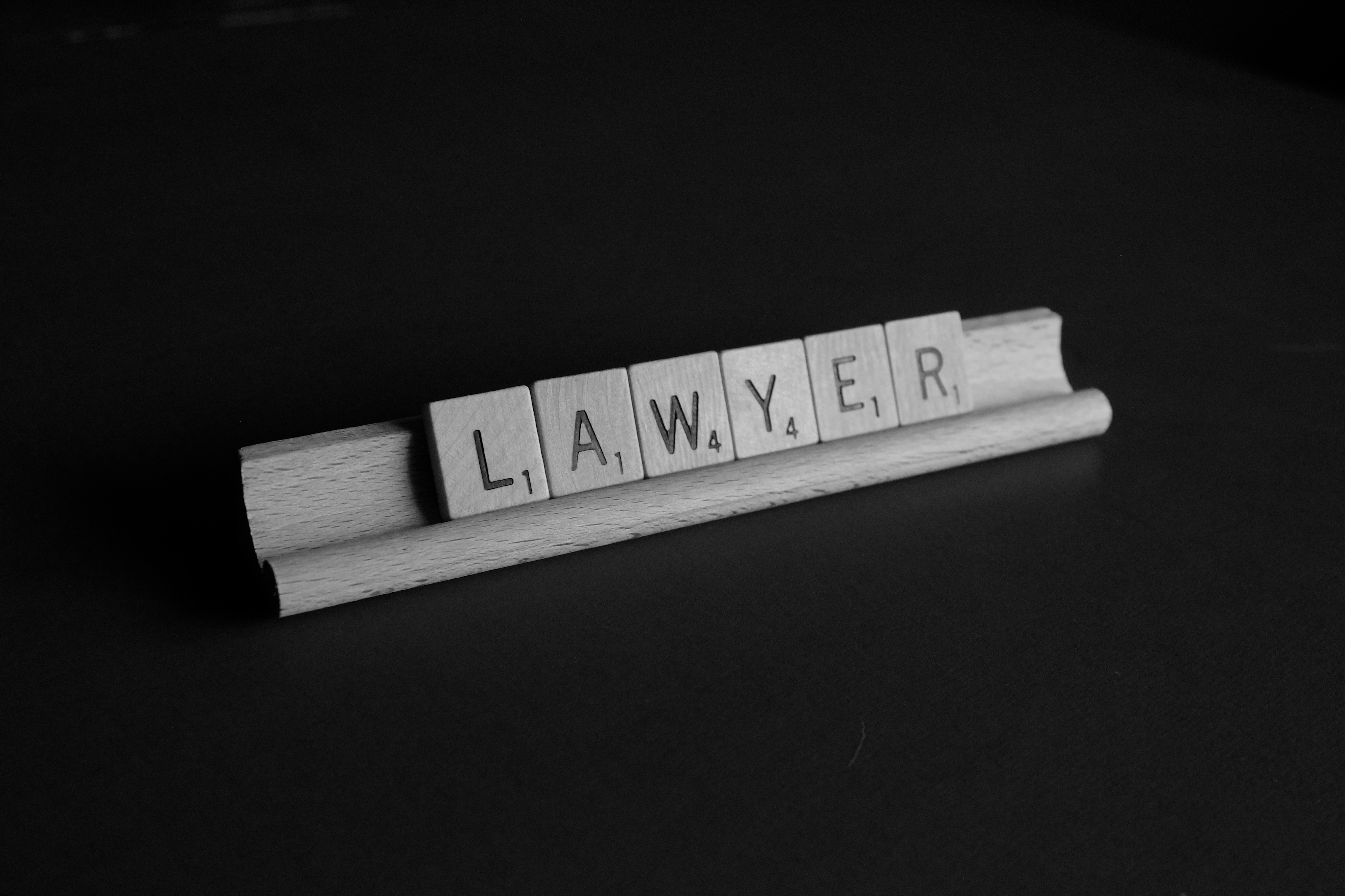 Scrabble board with lawyer as a word